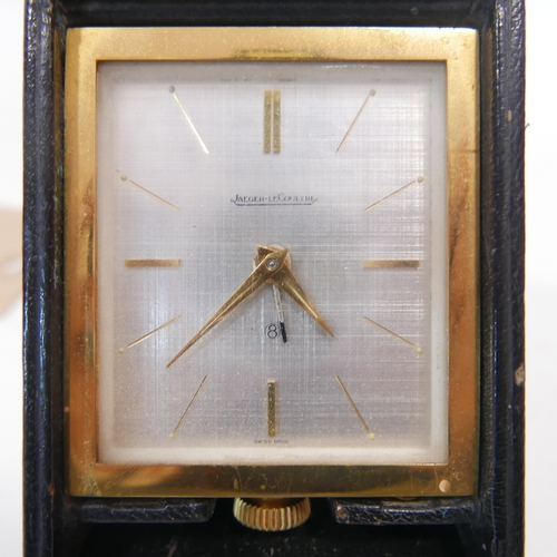46 - A Jaeger-LeCoultre 8-day travel alarm clock, H.11 W.6.5cm...