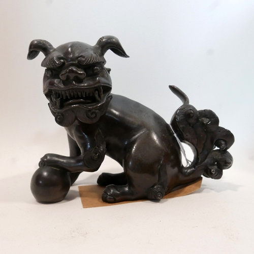 6 - Late 18th / early 19th century Chinese solid bronze Dog of Fo, H.15 W.19 D.9cm, on ebonised rectangu...