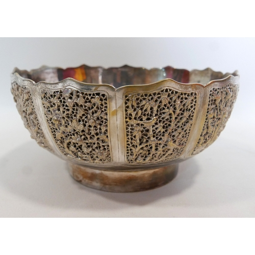 96 - An Indian white metal bowl, with pierced vignettes of birds on scrolling foliage, having floral engr...