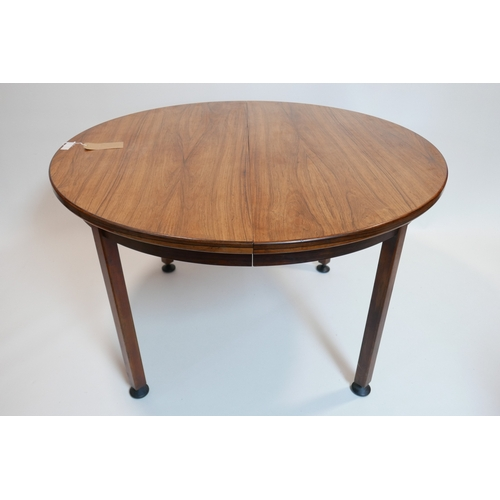 100 - A mid 20th century Danish exotic hardwood dining table with two extra leaves, H.74 W.210 D.120cm, 12...