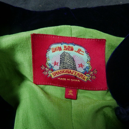 105 - A Chinese, navy blue velvet jacket with lime green silk interior lining. Bearing 2 labels for 'Shang...