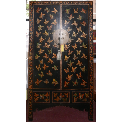 299 - An early 20th century Chinese black and red lacquered wedding cabinet, decorated with butterflies, t...