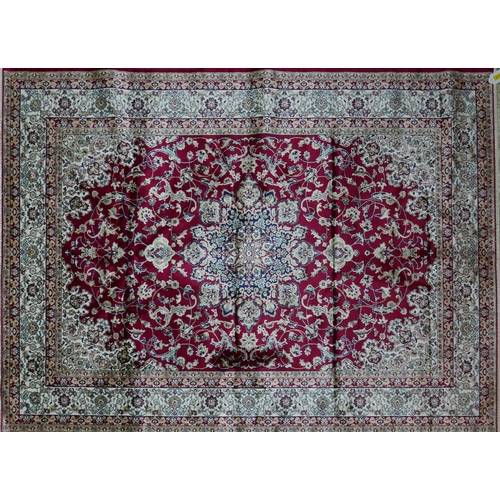 307 - A Kashan style carpet with central floral medallion, on a red ground, contained by floral borders, 2...