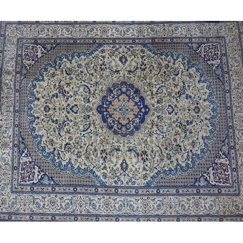 68 - A Central Persian part silk Nain carpet, double pendent medallion with repeating spandrels on an ivo...