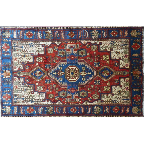 76 - A North West Persian Nahawand rug, double pendent medallion with repeating petal motifs on a terraco...