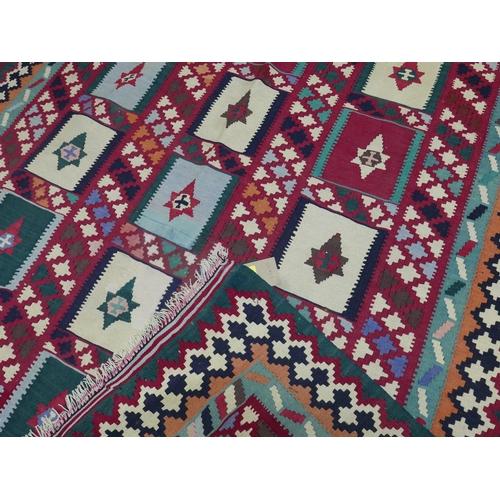 86 - A South West Persian Qashqai kilim, repeating stylised geometric motfis within stylised geometric bo...