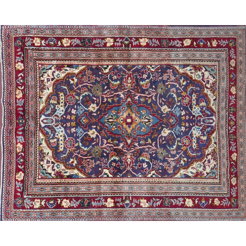 88 - A North West Persian Mahal carpet, double pendent medallion on a sapphire field, complimented by a s...