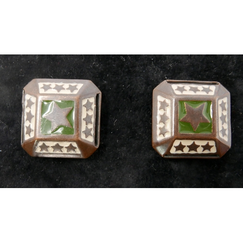 23 - A pair of vintage designer green and white enamelled metal clip earrings by Jean Paul Gaultier, circ...