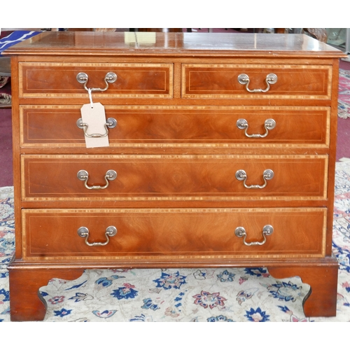 227 - A Georgian style mahogany chest, with walnut cross banding, two short over three long drawers, raise...