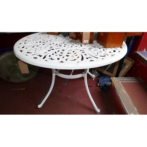 361 - A cast aluminium garden table...