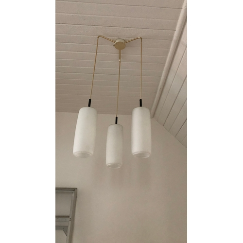 258 - A pair of vintage triple ceiling light pendants, by Marlin, with glass shades....