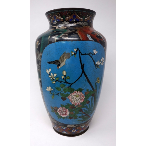 61 - A Chinese cloisonne enamel vase, decorated with vignettes of birds amongst flowers and dragons among...