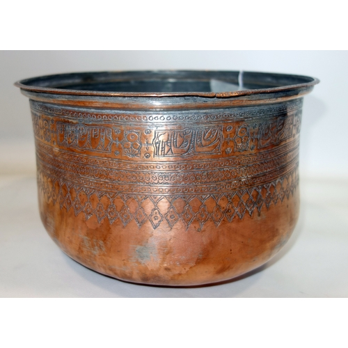 249 - An Islamic Qajar copper bowl decorated with incised geometric motifs and stylised flowers, H.19cm Di...