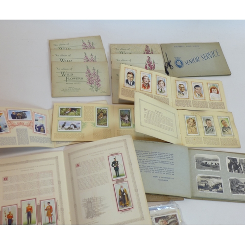 122 - A collection of vintage cigarette cards by Wills and John Player & Sons...
