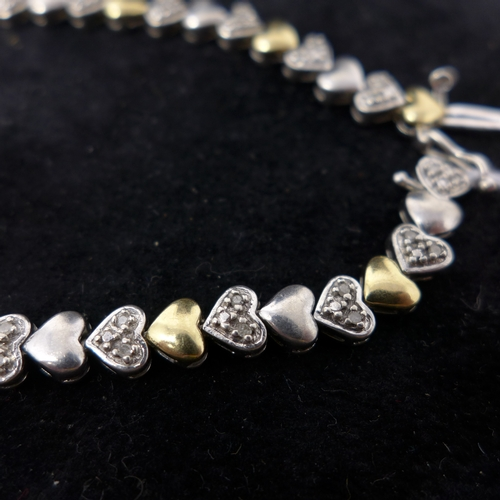 13 - A gold and silver bracelet set with diamonds...