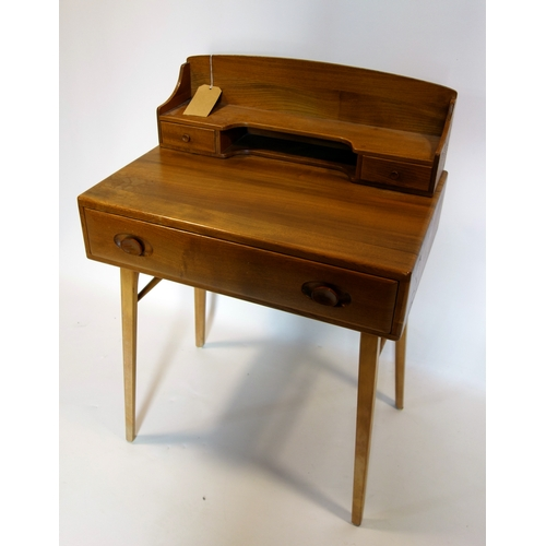 135 - A mid 20th century Ercol elm desk, H.95 W.68 D.46cm...