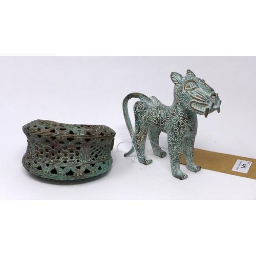 141 - A Benin bronze leopard and bronze bangle...