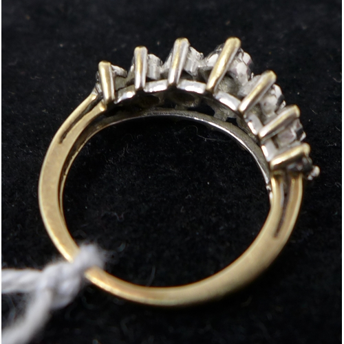19 - A yellow metal and diamond cluster ring...