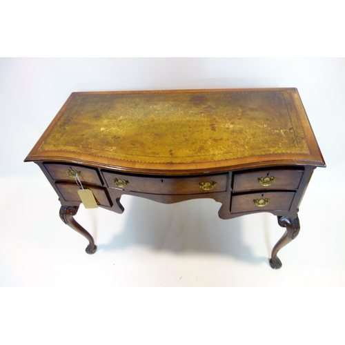 254 - A Georgian style mahogany serpentine fronted desk, with five drawers, raised on cabriole legs, H.78 ...