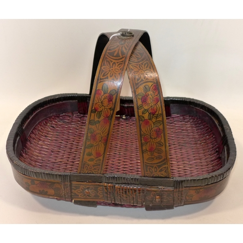 309 - A Chinese lacquered wicker fruit basket...