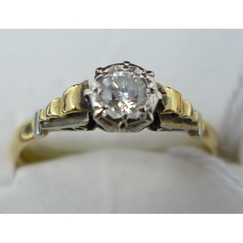 7 - An 18ct gold and platinum diamond solitaire ring...