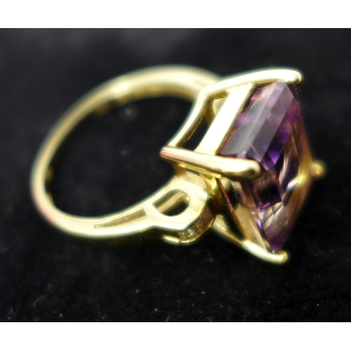 88 - A boxed 14ct yellow gold ametrine and diamond ring...