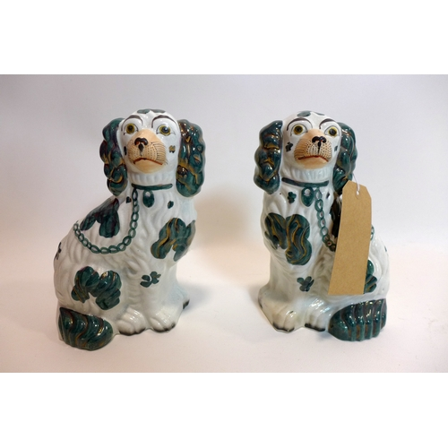 99 - A pair of late 19th century ceramic Staffordshire dogs with green, white and gold detailing, number ...
