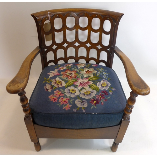 155 - A Gothic style oak chair with tapestry upholstered seat...