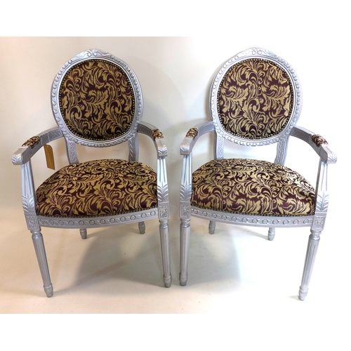 276 - A pair of silver painted armchairs...