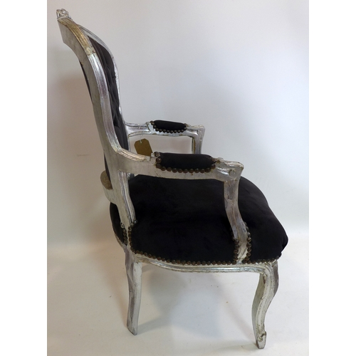 286 - A French silver painted armchair...