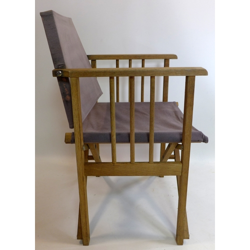300 - A pair of oak folding directors chairs...