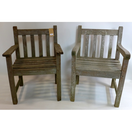 310 - A pair of garden chairs...