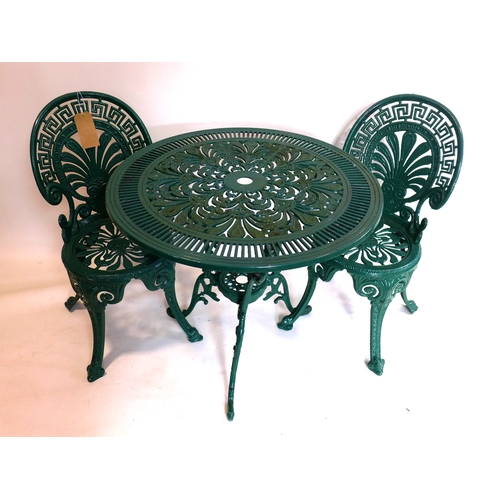 364 - A green painted cast aluminium garden table and chairs...