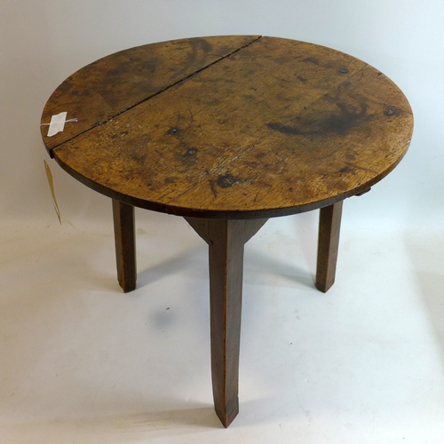 413 - An early 19th century elm cricket table, H.57 Diameter 67cm...