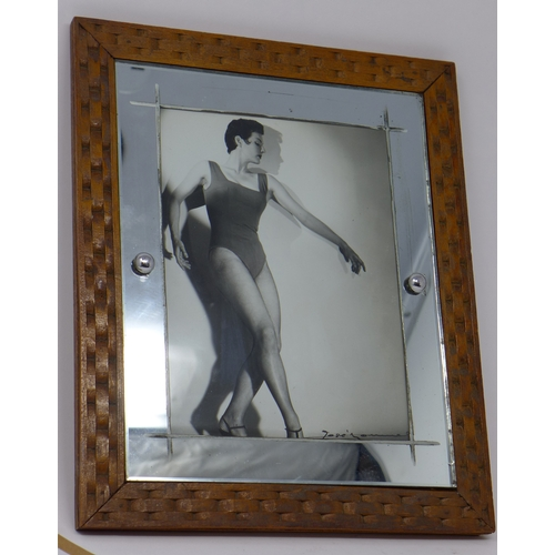 124 - A silver gelatin print of American dancer Cyd Charisse, indistinctly signed lower right, frame and w...