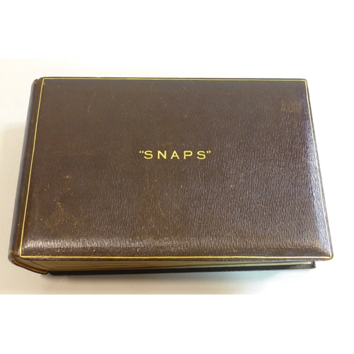 50 - A large brown leather-bound photo album  embossed in gilt letters to the top 'Snaps', circa 1920's, ...