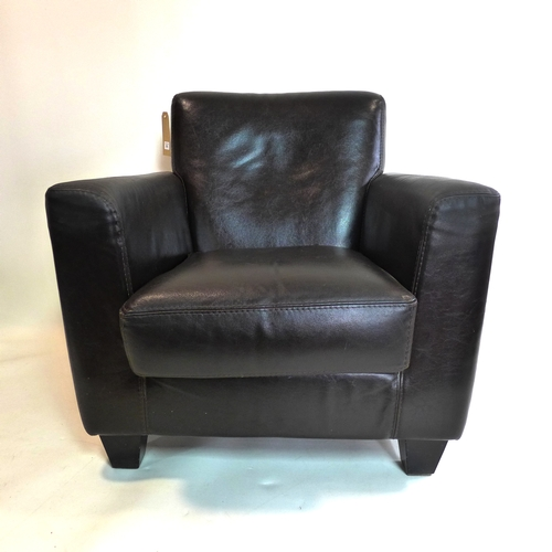 303 - A brown leather armchair...