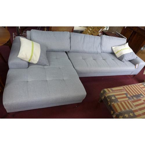 295 - A contemporary corner sofa with chrome legs...