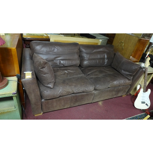 391 - A brown leather sofa...