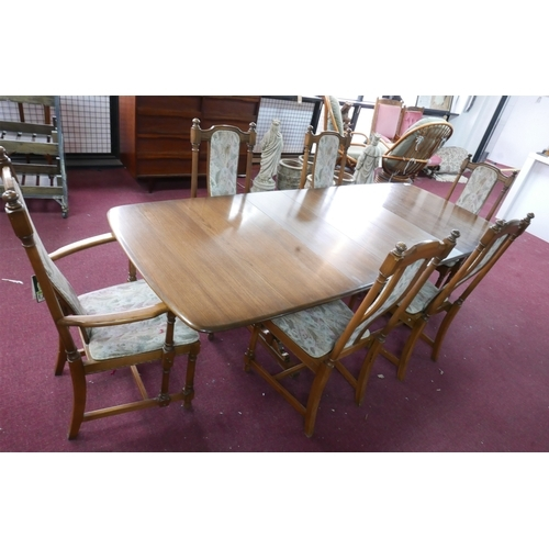 236 - An Ercol dining table with two extra leaves, H: 74 W: 250 D: 101cm, together with 6 matching dining ...