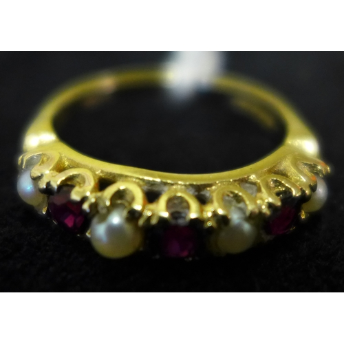 19 - A 9ct gold ring set with rubies and pearls...