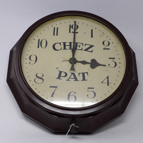 32 - An Art Deco Bakelite-cased electric clock with black Arabic numerals and 'Chez Pat' to dial, Dia: 40...