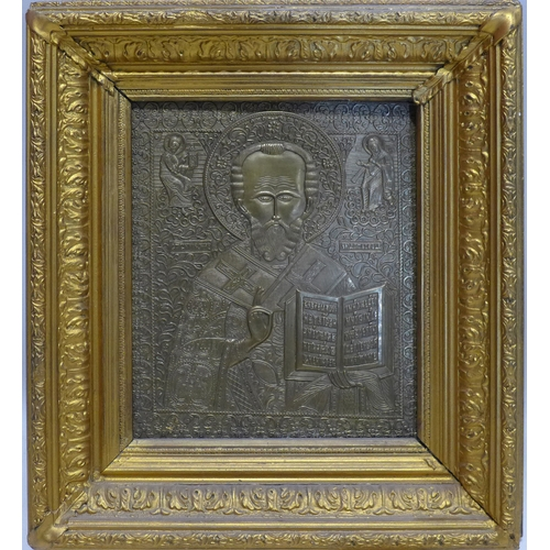 13 - A Russian bronze icon of St Nicholas of Myra, in an ornate gilt frame, 27 x 24cm (icon), 42 x 37cm (...