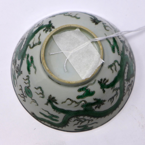 145 - A 19th century Chinese porcelain bowl in the famille verte palette decorated to the exterior with a ...