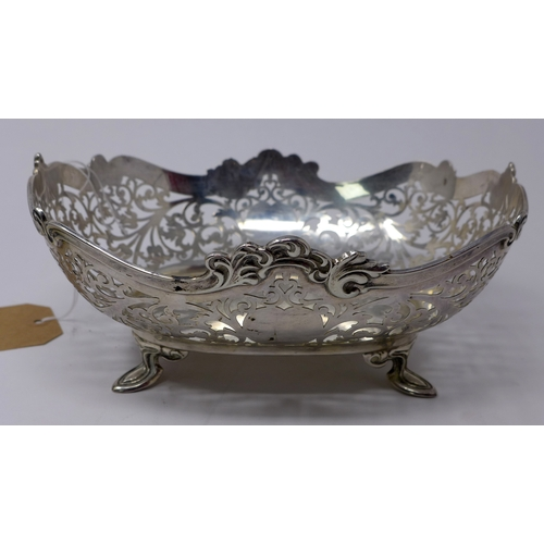 3 - An early 20th century silver dish with pierced decoration, 15oz...