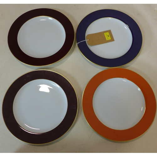 45 - 4 Legle Limoges porcelain dinner plates in various colours with 18ct gold rims, dia: 30cm each...