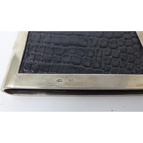 53 - A Victorian silver and crocodile skin cheque book holder...