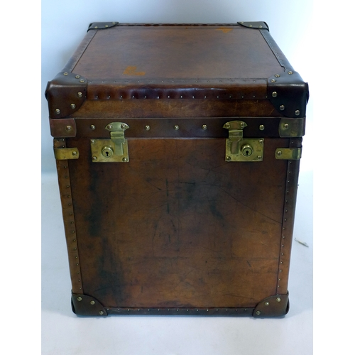 82 - A vintage leather lamp table/trunk, H.59 W.51 D.46cm...
