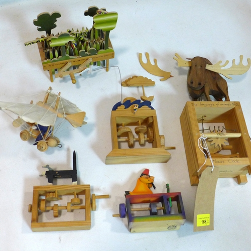 168 - A collection of scratch built mechanical toys, together with a plane mobile (6)...