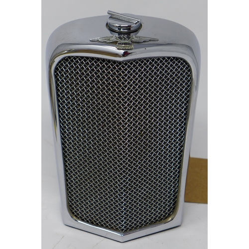 31 - A 1950/60's chrome flask in the form of a Jaguar radiator, H.18 W.11 D.7cm...